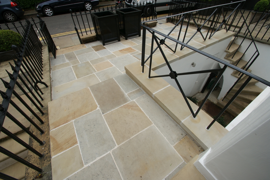 Image of second face yorkstone paving. https://stoneuk.com/products/reclaimed-second-face-english-yorkstone-paving/
