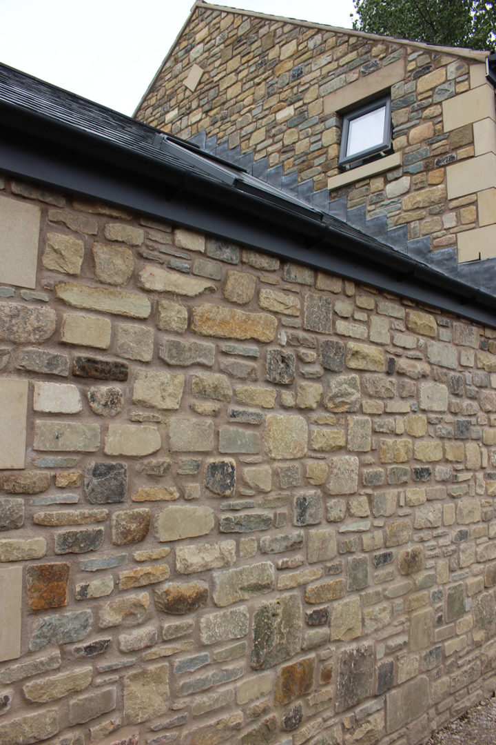Image of a side wall built with using Yorkstone reclaimed walling.https://stoneuk.com/products/reclaimed-walling/