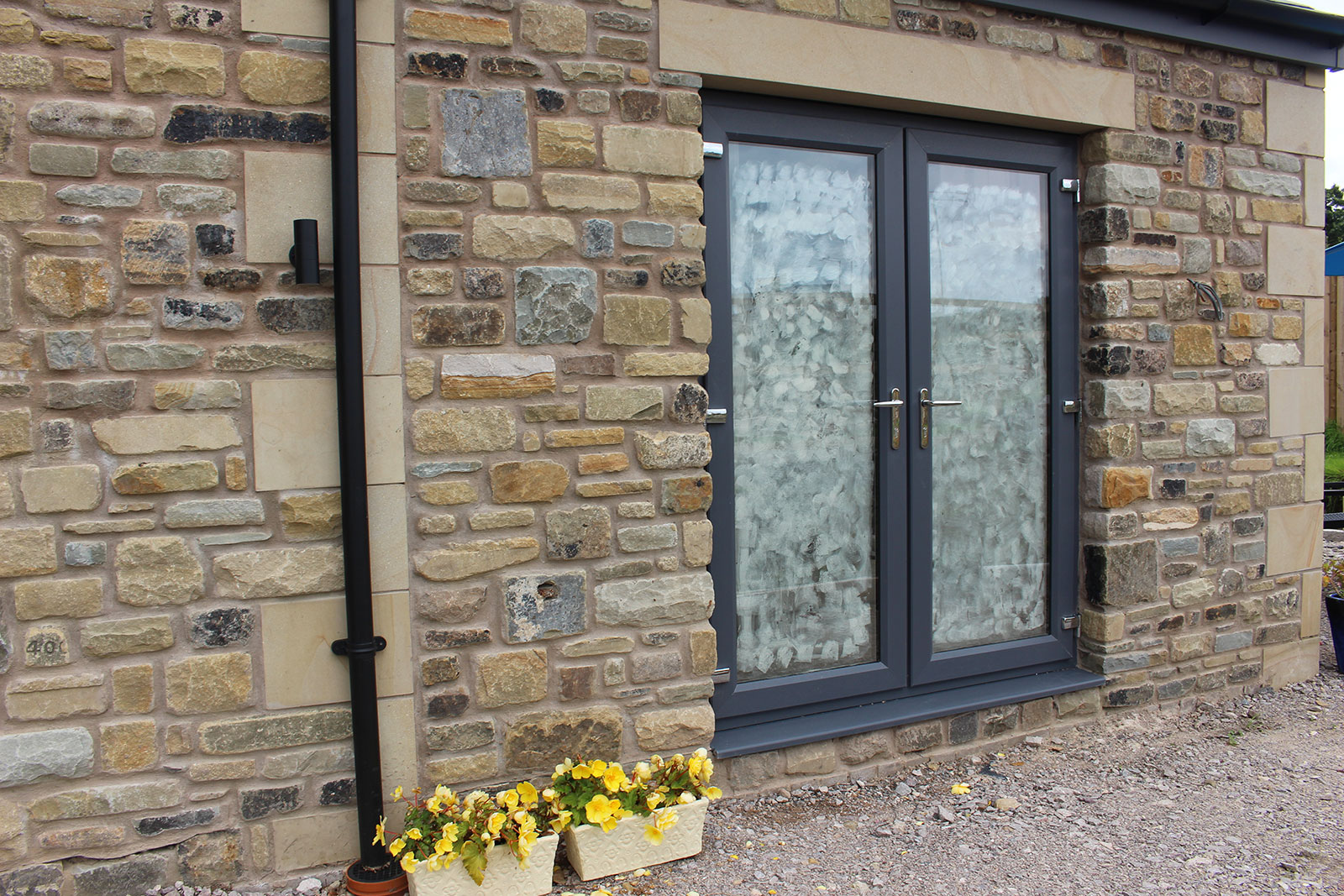 Image of yorkstone reclaimed walling. https://stoneuk.com/products/reclaimed-walling/