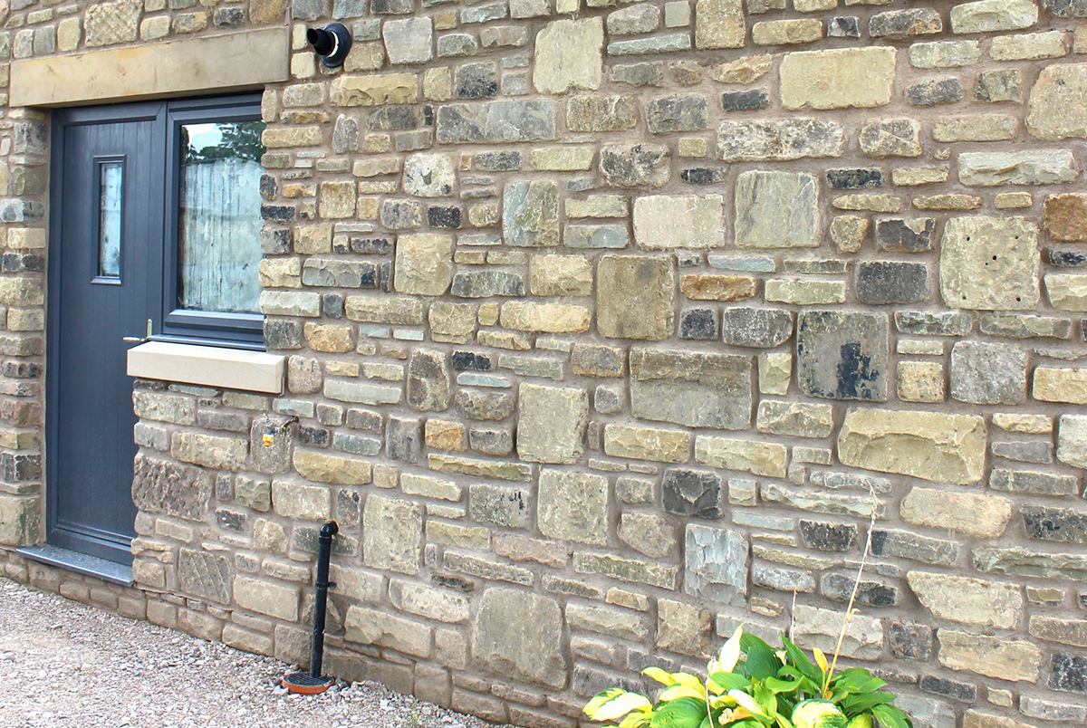 Image of a house built with stone walling materials