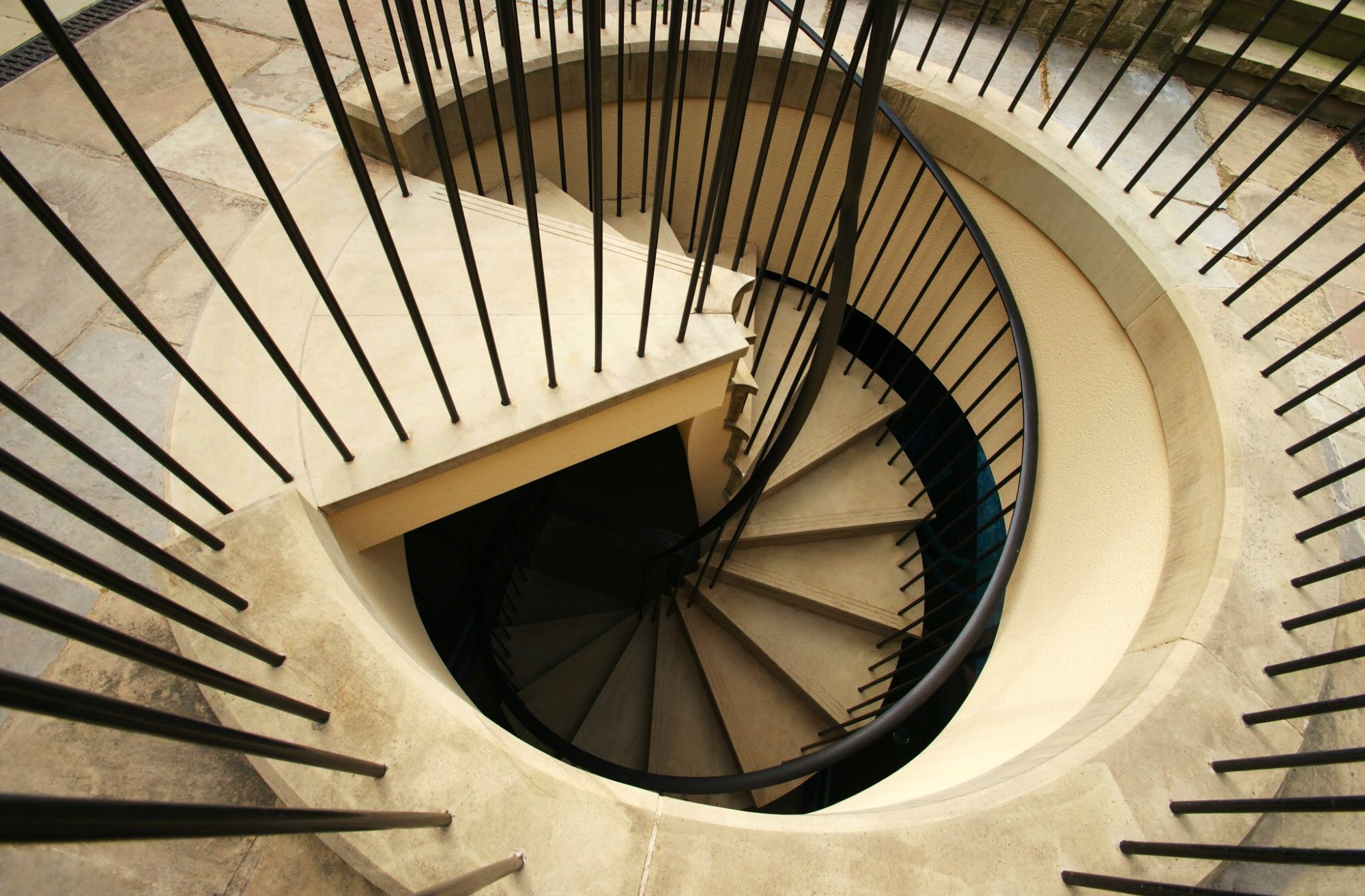 Image of spiral stairs designed using Yorkstone. https://stoneuk.com/